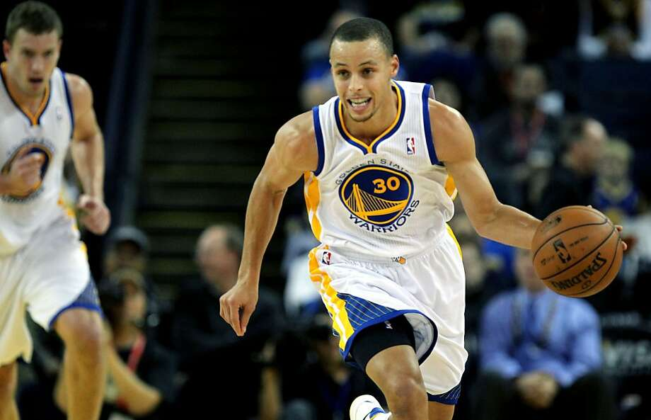 Golden State Warriors' Stephen Curry (30) runs the fast break against the Orlando MagicÕ during the first half of an NBA basketball game in Oakland, Calif., Monday, Dec. 3, 2012, Magic won 102-94. Photo: Lance Iversen, The Chronicle