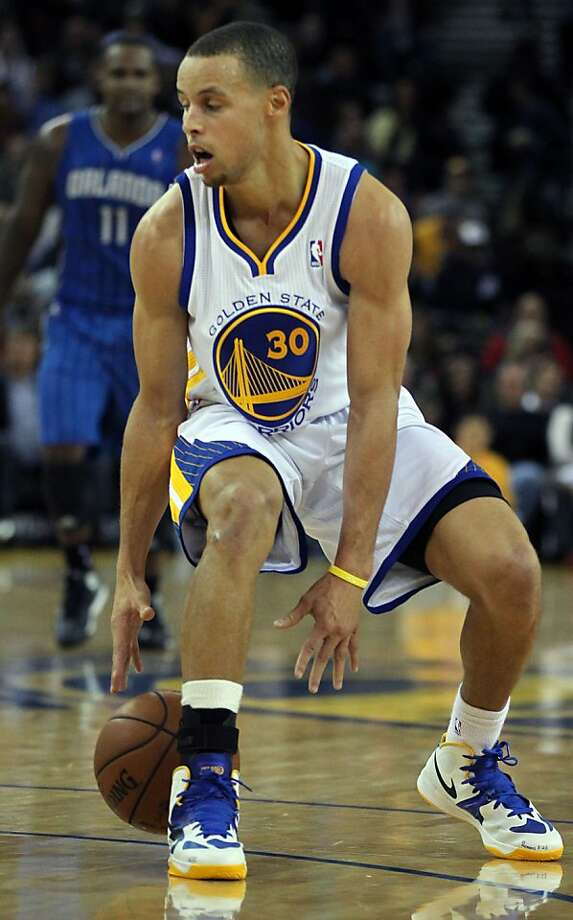 Golden State Warriors' Stephen Curry (30) moves the ball up court against the Orlando MagicÕ during the second half of an NBA basketball game in Oakland, Calif., Monday, Dec. 3, 2012. Warriors lost to the Magic 102-94 Photo: Lance Iversen, The Chronicle