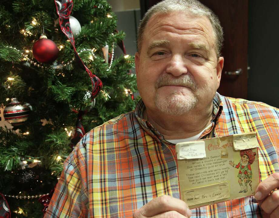 Rusty League received the card last year and has sent it on to another relative. He admitted to feeling sad before sending it, knowing that because the families are so large and spread out, he'll likely never see it again. Photo: Juanito M. Garza, San Antonio Express-News / San Antonio Express-News