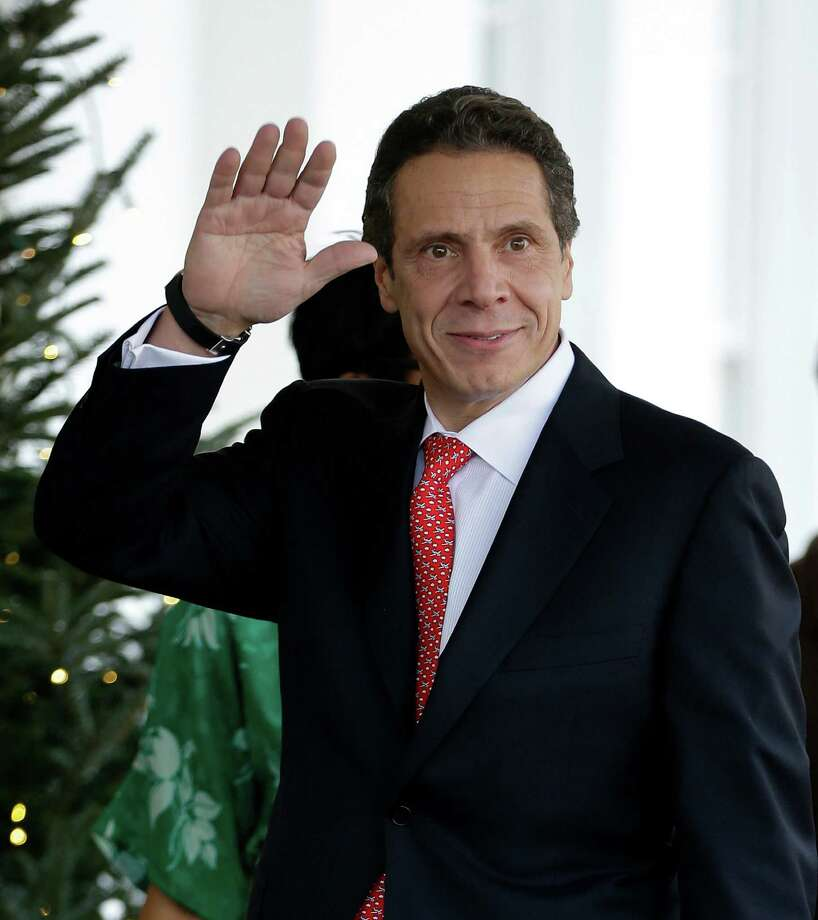 New York Gov. Andrew Cuomo waves to members of the media upon his arrival to the West Wing of the White House in Washington, Monday, Dec. 3, 2012, for a scheduled meeting with White House officials. (AP Photo/Pablo Martinez Monsivais) Photo: Pablo Martinez Monsivais