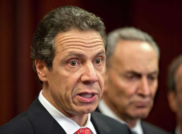 New York Gov. Andrew Cuomo is joined by the New York Congressional delegation as he comes to the Capitol in Washington to press officials for billions of dollars in aid to help his state recover from the devastation of Hurricane Sandy, Monday, Dec. 3, 2012. At right is Sen. Charles Schumer, D-NY.  (AP Photo/J. Scott Applewhite) Photo: J. Scott Applewhite