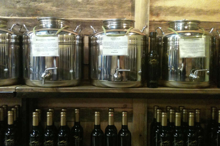 A large selection of fresh-pressed olive oils and infused balsamic vinegars makes for a perfect gift for food aficionados, available at Olivette in the new SoNo Market Place in Norwalk. Photo: Patti Woods / Fairfield Citizen contributed