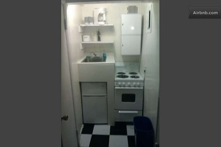 LaSalle says that 'cozy' secretly means 'really tiny and on the ground floor. While this listing doesn't say what floor the apartment is on, that is the 'coziest'  kitchenette we have ever seen!This 550-square-foot 1-bedroom in Grammercy Park rents for $175 a night, and garnered 4 out of 5 stars from visitors. (Airbnb)