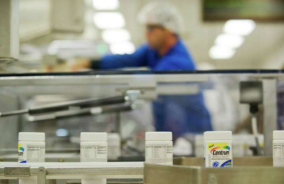 FILE- In this Thursday, July 12, 2012, file photo, Centrum multivitamins are shown on the packaging line at the Pfizer plant in Montreal Drugmaker Pfizer Inc. said Monday, Dec. , 2012, it is starting another round of layoffs, targeting U.S. sales representatives who promote Pfizer primary care medicines to doctors. The New York-based Viagra maker isn't giving details on how many salespeople it employs, how many will leave or when that will happen. Individual salespeople haven't been notified whether they'll be furloughed.(AP Photo/The Canadian Press, Graham Hughes, File) Photo: Graham Hughes