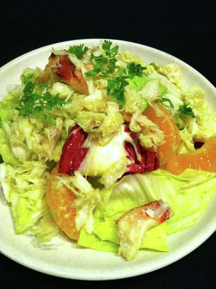 Contigo: Crab salad with chicories, clementines and avocado