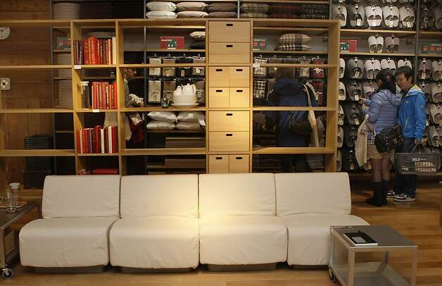 The polyurethane sectional sofa is a model of Muji functional simplicity - without frill, detail or arms, adjustable from loveseat to stretch length. Photo: Liz Hafalia, The Chronicle