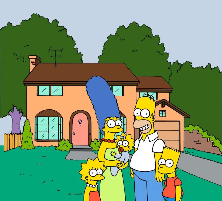 The Simpsons posing in front of their Springfield home. (AP Photo/Fox Broacasting Co.) (AP)