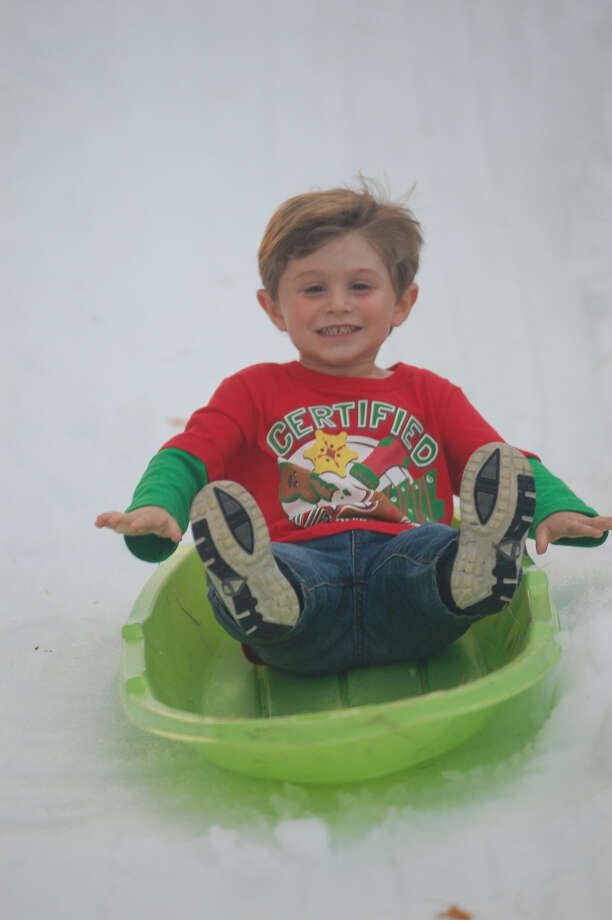 This youngster enjoys sledding down the snow slopes. Photo: Jimmy Galvan/Jasper Newsboy