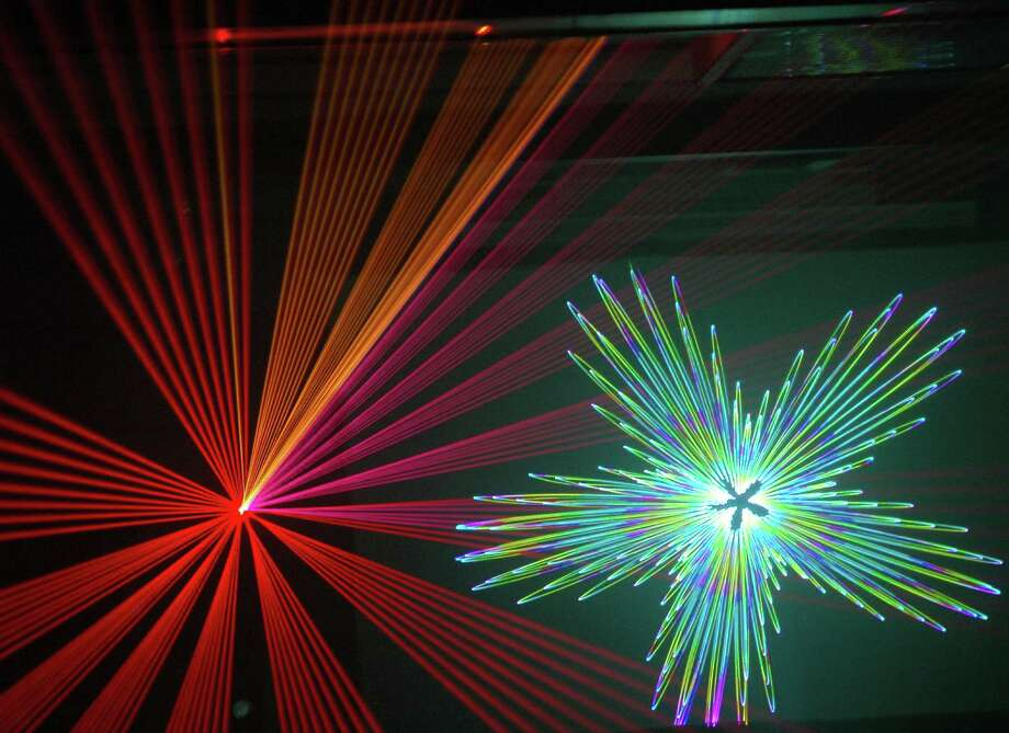 "The 45-minute URBAN-15 Holiday Laser Show will ""incorportate everything,"" laser artist Tim Walsh said. Courtesy URBAN-15 Photo: Courtesy URBAN-15"