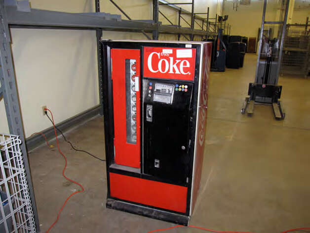 A Coca-Cola vending machine, an electric massage chair and a pair of leather chaps are among the 100 items being auctioned this Thursday, Dec. 6, 2012, by the San Antonio Police Department. The items will be available for viewing at 5:30 p.m. at the VFW Post No. 8196, 650 VFW Blvd., and bidding begins an hour later. Photo: Courtesy Photo