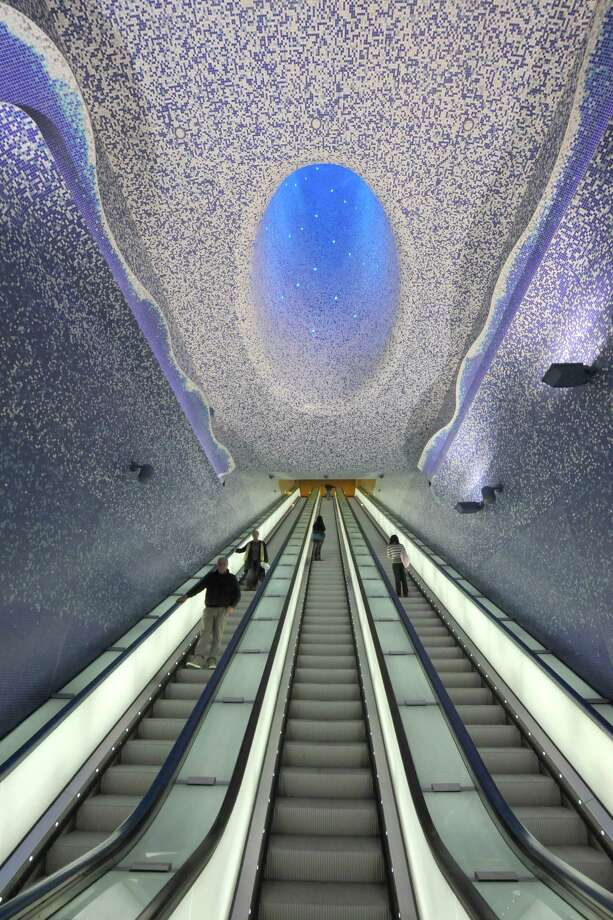 "People walk in the ""Cathedral"" with the Crater of Luz by artist Oscar Tusquet Blanca in the Toledo subway station as part of the ""Art Station Line 1"" project on Nov. 5, 2012, in Naples. Photo: MARIO LAPORTA, AFP/Getty Images / AFP"