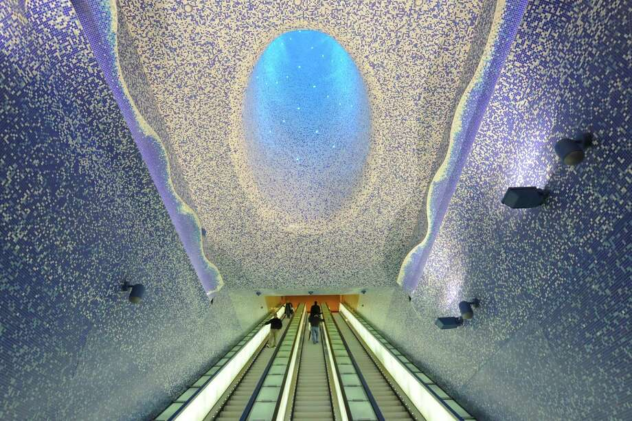 "People walk in the ""Cathedral"" with the Crater of Luz by artist Oscar Tusquet Blanca in the Toledo subway station as part of the ""Art Station Line 1"" project in Naples. Photo: MARIO LAPORTA, AFP/Getty Images / AFP"