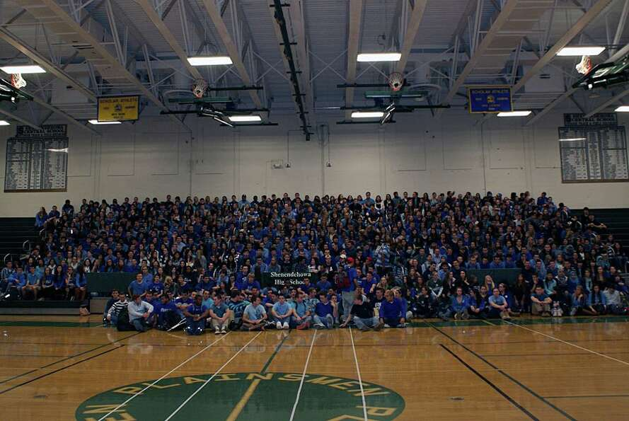 Shenendehowa students, most wearing blue in support of Shaker student Bailey Wind, gathered in the g