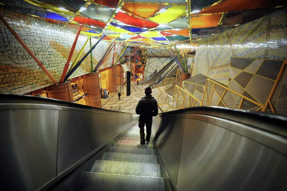 A subway passenger stands on an escalator at the Olaias metro station in Lisbon on Nov. 26, 2012. Photo: MIGUEL RIOPA, AFP/Getty Images / AFP