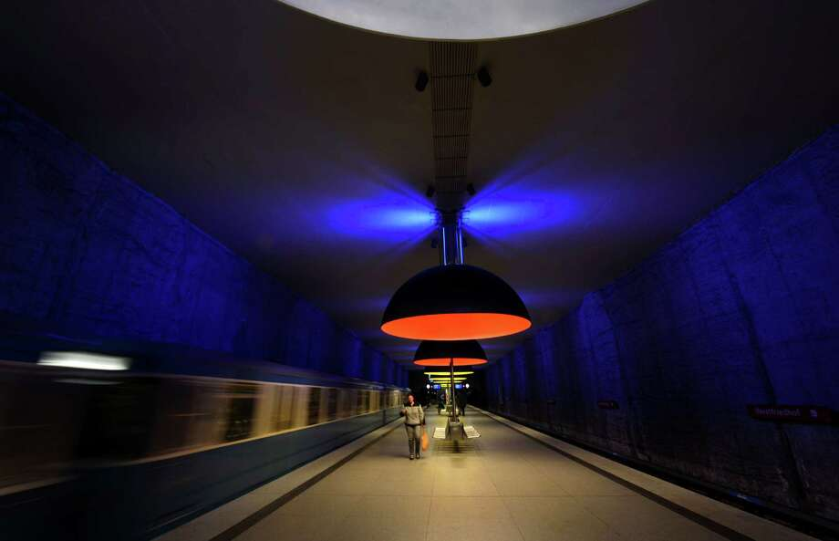 A train leaves the subway station Westfriedhof in Munich, southern Germany, on Nov. 14, 2012. The subway station was opened on May 23, 1998. 11 large lamps measuring 3.80 metres in diameter were installed in 2001 and bathe the station in blue, red and yellow light. Photo: CHRISTOF STACHE, AFP/Getty Images / AFP