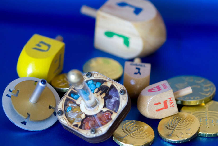 Spinning the dreidel is often associated with the rewards of chocolate gelt at Chanukah time (Photo: AP) Photo: Unknown
