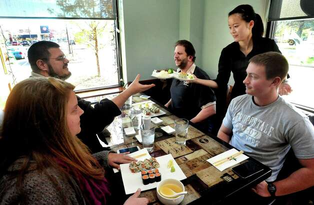 Kate Chen serves customers during lunch at Ki Asian Bistro & Sushi in Danbury Wednesday, Nov. 21, 2012. Photo: Michael Duffy / The News-Times