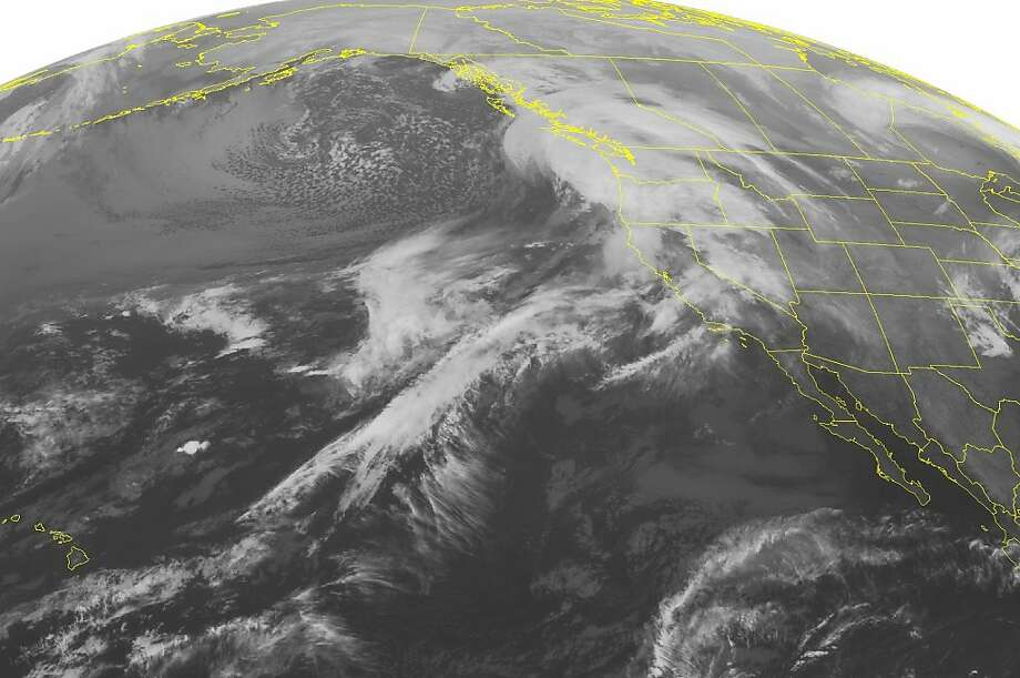 This NOAA satellite image taken Tuesday, Dec. 4, 2012 at 1:00 a.m. EST shows a storm system moving into the Pacific Northwest and northern California. Heavy rain and heavy mountain snow across these areas are possible as this system moves eastward. Photo: Associated Press