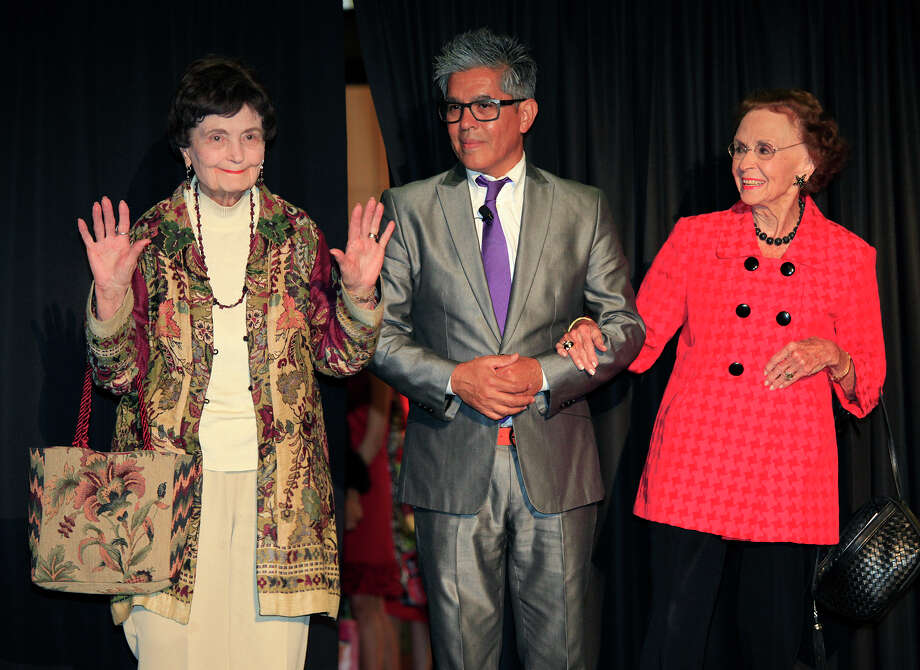 Event MC Michael Quintanilla escorts Lila Cockrell, left, and Edith McAllister, right, for their runway introduction kicking-off Project 3-C Runway benefiting the Women's Pavilion at HemisFair featured handbags, accessories and fashions sewn from recycled banners by the women of Fuerza Undida, Tuesday, October 18, 2011 at The Pearl Brewery Breezeway and AIA at The Pearl in San Antonio. Photo: J. MICHAEL SHORT, SPECIAL TO THE EXPRESS-NEWS / THE SAN ANTONIO EXPRESS-NEWS