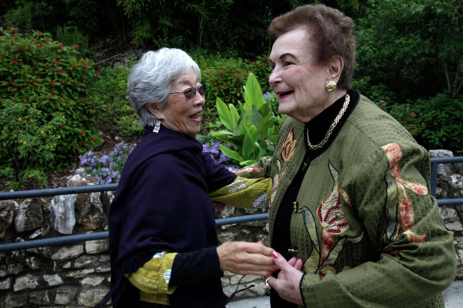 The San Antonio Parks Foundation President and former Mayor Lila Cockrell greets Mabel Jingu Enokoji before the announcement of plans to restore the Jingu House at the Japanese Tea Garden, Monday, Oct. 12, 2009. Enokoji is the daughter of the garden creator, Kimi Eizo Jingu. Enokoji and her family lived in the house between 1926 and 1942. Photo: JERRY LARA, San Antonio Express-News / glara@express-news.net