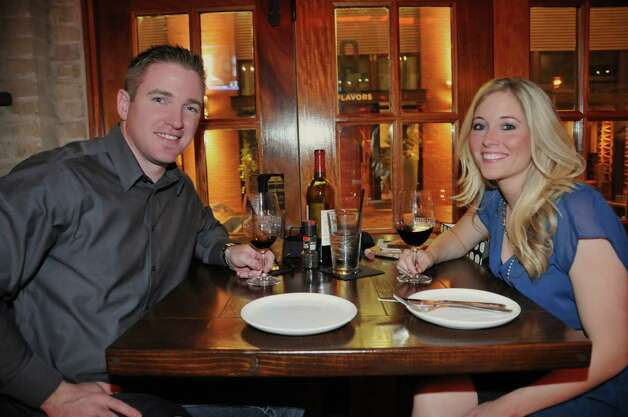 Matt Nesbitt and Brittney Perrin are enjoying a glass of wine and patiently waiting for their favorite dishes at the Boiler House.