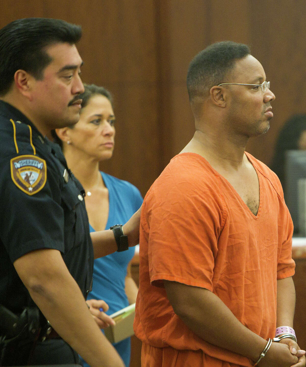 Keith Edward Grimmett is escorted out of court in Houston on Tuesday.