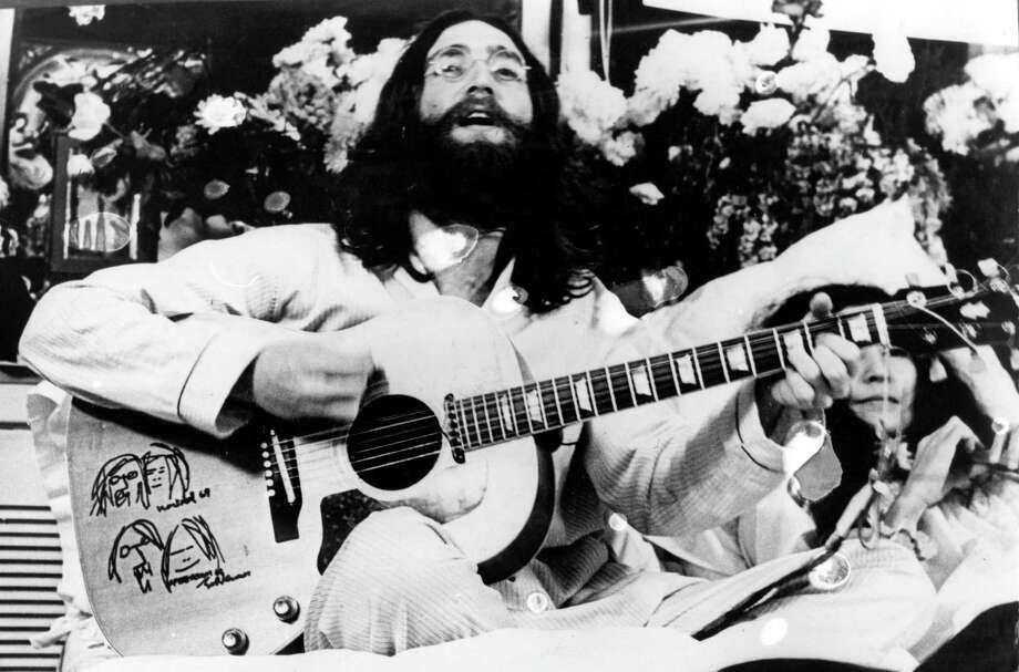 "John Lennon (1940-'80) of the Beatles famously stayed in bed in a hotel in Canada as part of a peace protest in 1969. He recorded ""Give Peace a Chance"" there. Photo: Getty Images / Hulton Archive"