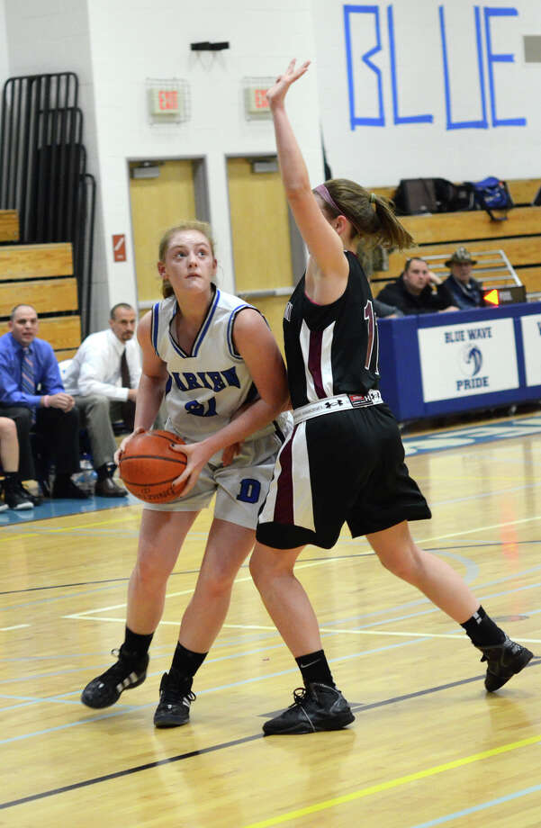 Darien's Meg Marren (21) looks to shoot as Farmington's Ally Walsh (11) defends during the girls basketball game at Darien High School on Tuesday, Feb. 28, 2012. Photo: Amy Mortensen