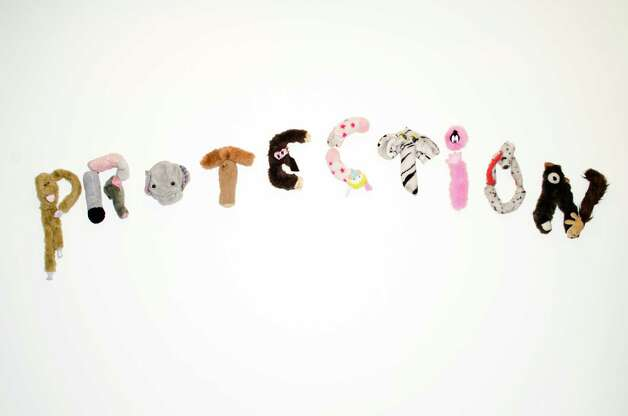 "Annette Messager used well-loved stuffed animals to spell out the title of her 1998 work ""Protection,"" featured in ""Hieroglyphs."""