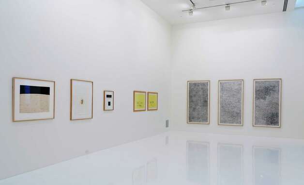 "Works by Antony Gormley (left three), Tracey Emin (yellow two) and Gabriel Orozco are featured in ""Hieroglyphics,"" an exhibition exploring the relationship between ""gesture and text,"" at the Linda Pace Foundation. Photo: ANSEN SEALE"