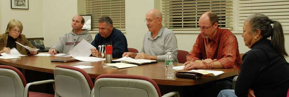 Members of the Golf Advisory Committee, from left, Joanna Nicholson, Gary Solomon, Mark Howod, Chairman Fred Hunter, Scott Smith, and Jean Murdoch, discuss issues of managing the Longshore Club golf course Monday night.  Westport CT 12/3/12 Photo: Jarret Liotta / Westport News contributed
