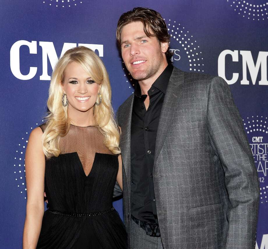 Carrie Underwood and Mike Fisher attend the 2012 CMT Artists Of The Year Awards at The Factory At Franklin on December 3, 2012 in Franklin, Tennessee.  (Photo by Erika Goldring/Getty Images) Photo: Erika Goldring, Getty Images / 2012 Getty Images
