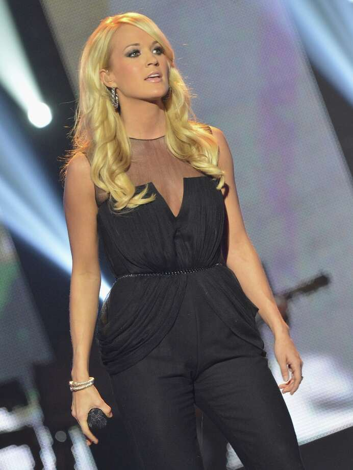 Carrie Underwood performs onstage during the 2012 CMT Artists Of The Year at The Factory at Franklin on December 3, 2012 in Franklin, Tennessee.  (Photo by Rick Diamond/Getty Images for CMT) Photo: Rick Diamond, Getty Images For CMT / 2012 Getty Images