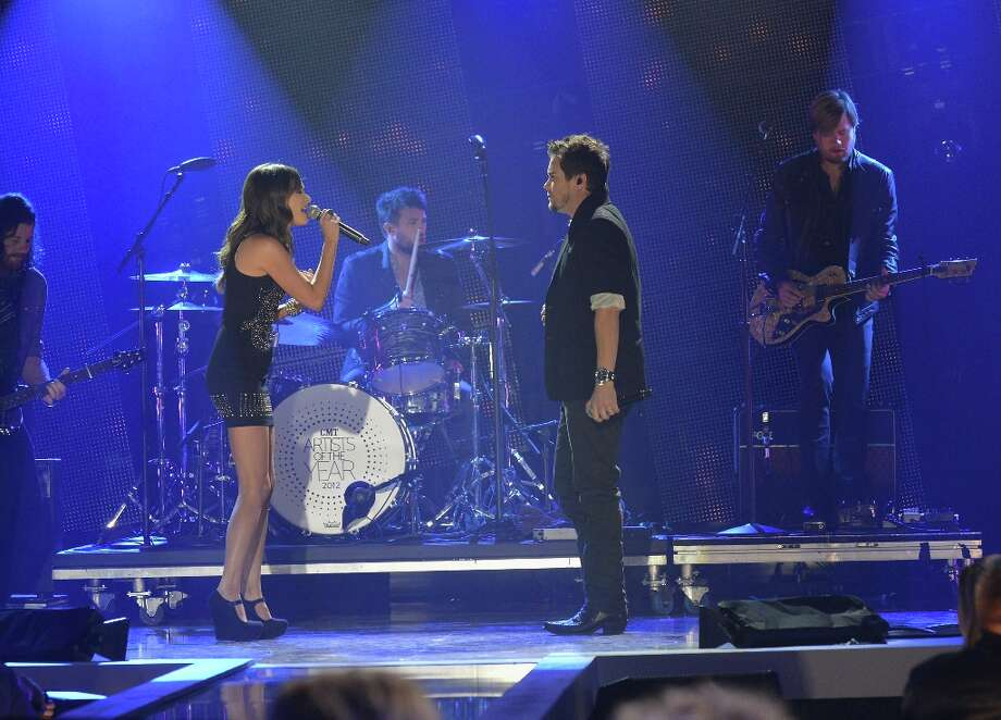 Kacey Musgraves performs with Mike Eli and the Eli Young Band onstage during the 2012 CMT Artists Of The Year at The Factory at Franklin on December 3, 2012 in Franklin, Tennessee.  (Photo by Rick Diamond/Getty Images for CMT) Photo: Rick Diamond, Getty Images For CMT / 2012 Getty Images