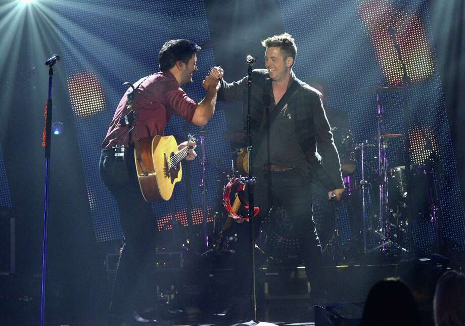 Luke Bryan and Ryan Tedder perform onstage during the 2012 CMT Artists Of The Year at The Factory at Franklin on December 3, 2012 in Franklin, Tennessee.  (Photo by Rick Diamond/Getty Images for CMT) Photo: Rick Diamond, Getty Images For CMT / 2012 Getty Images