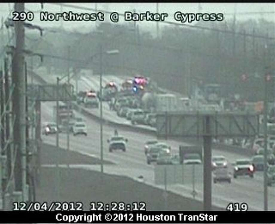 Portions of U.S. 290 eastbound were shut down after a six-car pileup in northwest Harris County about noon Tuesday. Photo: Houston Transtar