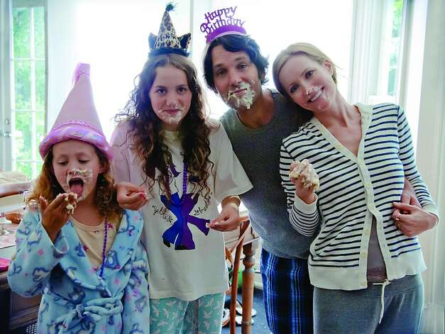 "left to right: Iris Apatow, Maude Apatow, Paul Rudd and Leslie Mann in Judd Apatow's ""This Is 40"" Photo: Universal"