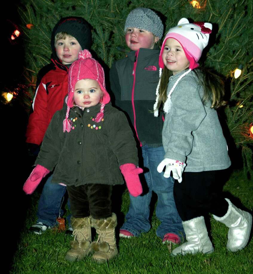 Festival of Lights  New Milford's traditional Festival of Lights proved a time for adventure Saturday for many area children, who were seen dashing amongst the lighted Christmas trees on the Village Green, often posing for photos by their parents. Above, 17-month-old Emilee Shanks, front, stoically shares the spotlight with, from left to right, Austin Shanks, 4, Cienna McNamara, 3, and Kelsey Blom, 3, all of New Milford. For more photos from the Greater New Milford Chamber of Commerce event, see the Dec. 7 edition of The Spectrum and visit www.newmilfordspectrum.com. Photo: Trish Haldin