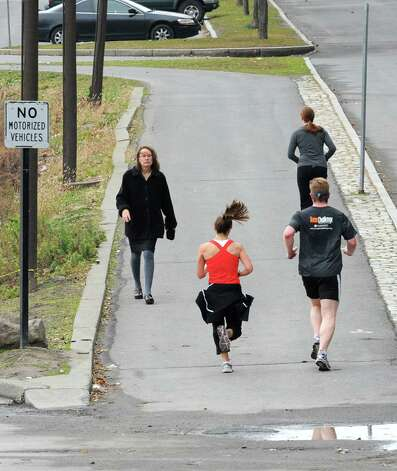 Joggers take advantage of the nice weather on  the Corning Trail at the Corning Preserve on Tuesday Dec. 4, 2012 in Albany, N.Y. (Lori Van Buren / Times Union) Photo: Lori Van Buren