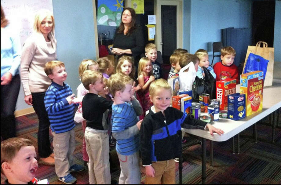 The Mark's Nursery School 4-year-old students and their teachers look over their donations to the New Canaan Food Pantry. Photo: Contributed