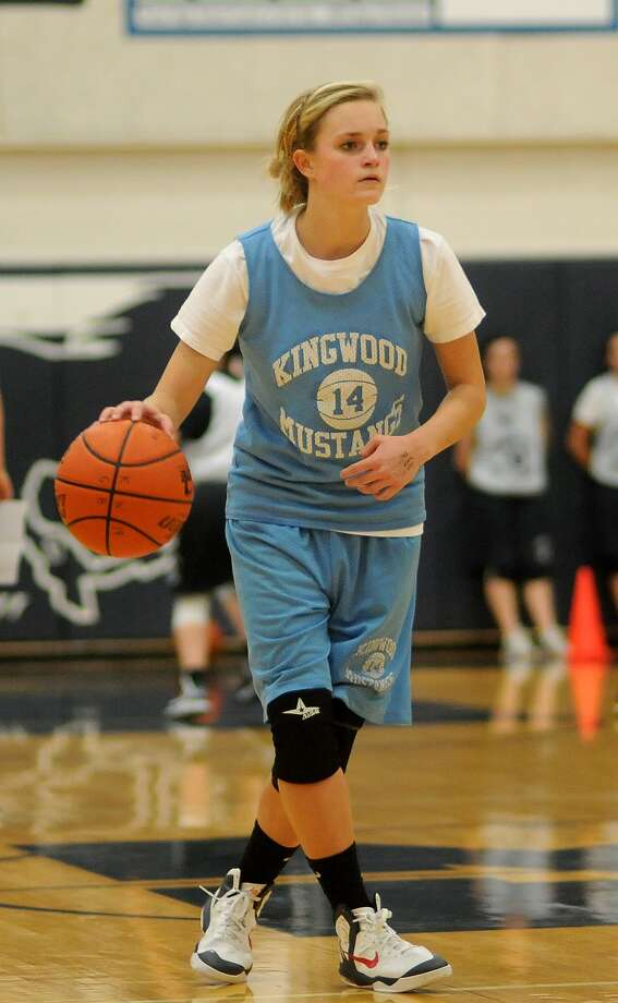Kingwood sophomore guard Gabrielle Stanton runs the offense during a team practice. Photo: Jerry Baker, Freelance