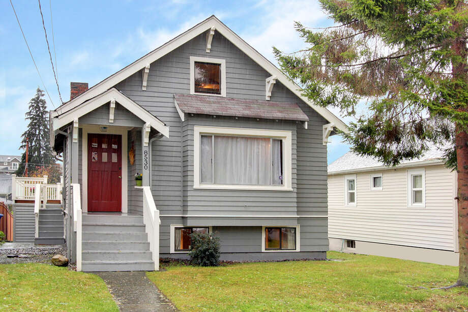 If you want an affordable home close to Ballard, Crown Hill's a good choice. Here are three houses listed there for around $385,000, starting with 8530 18th Ave. N.W. The 1,040-square-foot house, built in 1929, has two bedrooms, two bathrooms, a vaulted ceiling in the living room, a loft, a deck and an office on a 4,000-square-foot lot. It's listed for $385,000. Photo: Courtesy Carmen A. Kloth/Windermere Real Estate