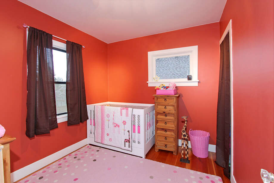 Main-floor bedroom of 8530 18th Ave. N.W. The 1,040-square-foot house, built in 1929, has two bedrooms, two bathrooms, a vaulted ceiling in the living room, a loft, a deck and an office on a 4,000-square-foot lot. It's listed for $385,000. Photo: Courtesy Carmen A. Kloth/Windermere Real Estate