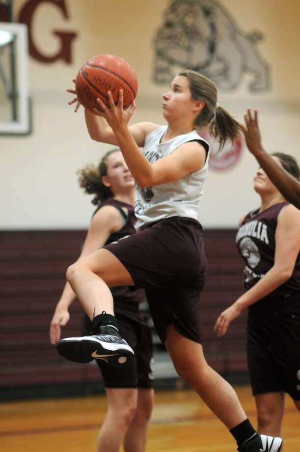 Magnolia senior forward Allison Abendschein, center, drives to the hoop during a recent Lady Bulldog practice. Photo: Jerry Baker, Freelance