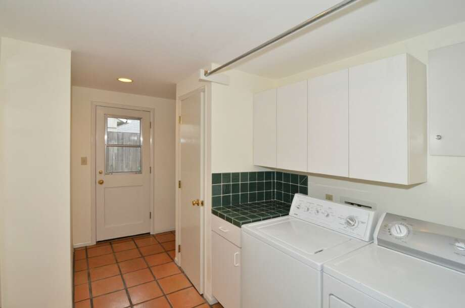 Mud/laundry room of 10032 Dibble Ave. N.W. The 1,300-square-foot rambler, built in 1948, has three bedrooms, 1.75 bathrooms and a covered patio on a 8,395-square-foot lot. It's listed for $385,500. Photo: Courtesy Gary Showalter/Keller Williams Realty Bothell