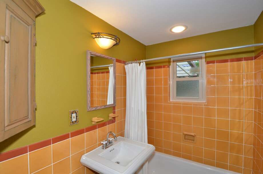 Bathroom of 10032 Dibble Ave. N.W. The 1,300-square-foot rambler, built in 1948, has three bedrooms, 1.75 bathrooms, a mud/laundry room and a covered patio on a 8,395-square-foot lot. It's listed for $385,500. Photo: Courtesy Gary Showalter/Keller Williams Realty Bothell