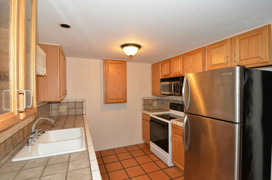 Kitchen of 10032 Dibble Ave. N.W. The 1,300-square-foot rambler, built in 1948, has three bedrooms, 1.75 bathrooms, a mud/laundry room and a covered patio on a 8,395-square-foot lot. It's listed for $385,500. Photo: Courtesy Gary Showalter/Keller Williams Realty Bothell