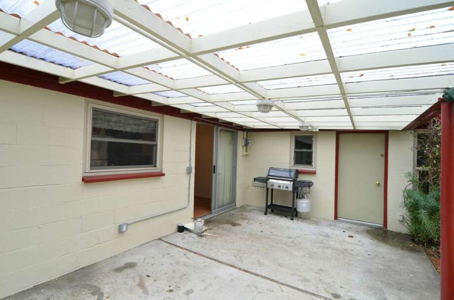 Covered patio of 10032 Dibble Ave. N.W. The 1,300-square-foot rambler, built in 1948, has three bedrooms, 1.75 bathrooms and a mud/laundry room on a 8,395-square-foot lot. It's listed for $385,500. Photo: Courtesy Gary Showalter/Keller Williams Realty Bothell