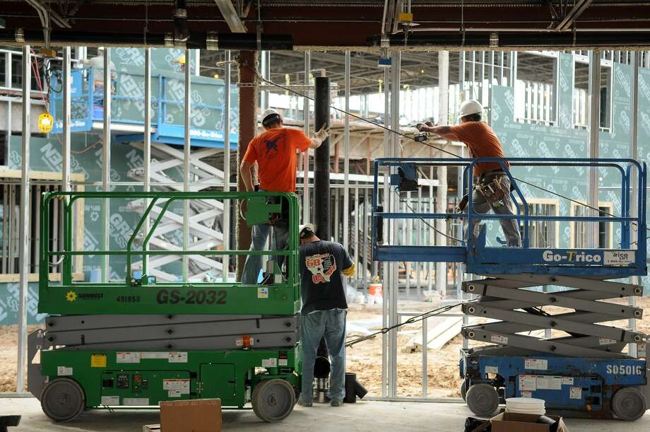 Work continues in the pre-kindergarten area of Humble ISD's Elementary School 27. The school should help relieve some of the overcrowding at Fall Creek and Park Lakes elementaries. Photo: Jerry Baker, Freelance