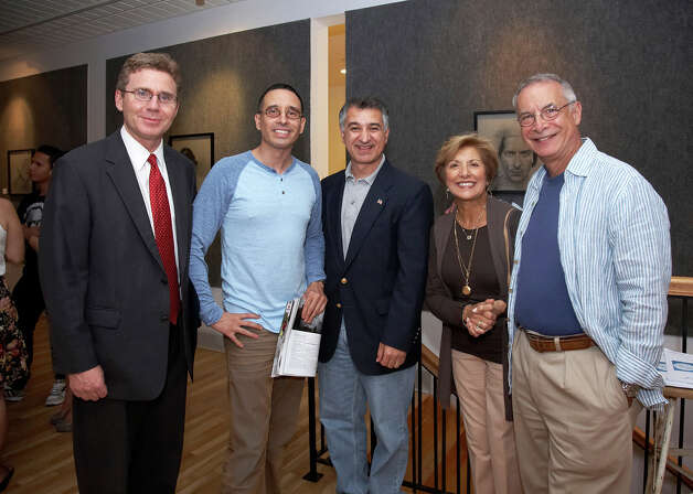 "State Rep. Gerry Fox (D-Stamford); Fernando Luis Alvarez, owner of the Fernando Alvarez Gallery in Stamford; State Sen. Carlo Leone (D-Stamford); Sandy Goldstein, president of the Downtown Special Service District; and Bob Goldstein at the FLA Gallery in September. The gallery will celebrate its third anniversary with an exhibition, ""3 Year Anniversary: 10 Artists, 10 Parties,"" which opens with a public reception on Friday, Dec. 14. Photo: Contributed Photo"